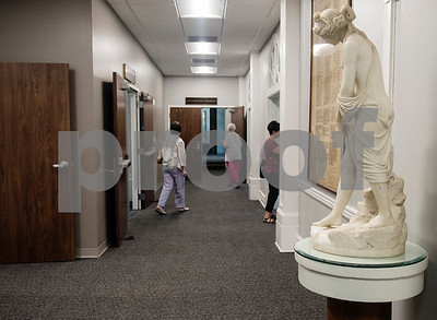 A statue of a woman stands in the hallway as people tour the remodeled Tyler Woman's Building,  911 South Broadway Avenue, during an open house for the United Way of Smith County which is now headquartered there. The historic building, built in 1932, was remodeled by Fitzpatrick Architects.  (Sarah A. Miller/Tyler Morning Telegraph)