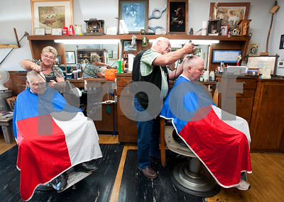 photo by Sarah A. Miller/Tyler Morning Telegraph  Husband and wife barber duo Becky Lasseter, 58 and Cliff Lasseter, 69, each attend to their customers Wednesday July 7th, 2013 at Cliff's Precision Kuts in Tyler. Lasseter has been a licensed barber since 1962  and opened Cliff's Precision Kuts in 1968. Pictured at left is customer Jack Baber of Tyler and at right Earl Rawls of Tyler.