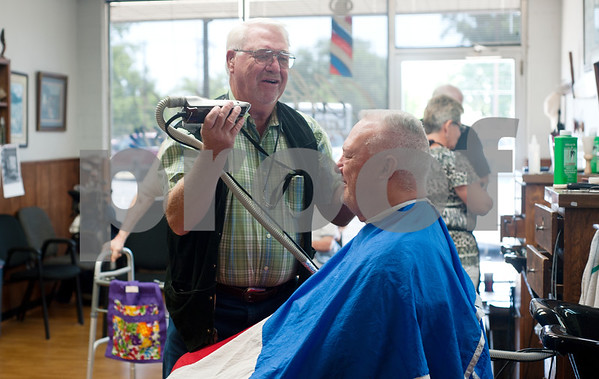 photo by Sarah A. Miller/Tyler Morning Telegraph  Tyler barber Cliff Lasseter, 69, cuts Tyler resident Earl Rawl's hair, 70, Wednesday July 7th, 2013 at Cliff's Precision Kuts in Tyler. Lasseter has been a licensed barber since 1962  and opened Cliff's Precision Kuts in 1968.