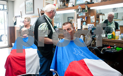 photo by Sarah A. Miller/Tyler Morning Telegraph  Customer Sam Bercher's, 51, of Bullard, jokes around with Tyler barber Cliff Lasseter, 69, as he prepares to cut Bercher's hair Wednesday July 7th, 2013 at Cliff's Precision Kuts in Tyler.