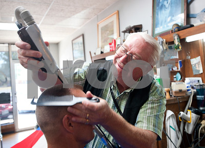 photo by Sarah A. Miller/Tyler Morning Telegraph  Tyler barber Cliff Lasseter, 69, gives customer Sam Bercher's, 51, of Bullard a flat top Wednesday July 7th, 2013 at Cliff's Precision Kuts in Tyler.