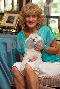 photo by Sarah A. Miller/Tyler Morning Telegraph   Dinah Miller of Tyler holds Reese, her pet dog who ran away during a trip to Dallas in 2007. Reese was discovered recently in Tacoma, Washington and was returned home to the Miller family in Texas Tuesday.