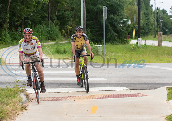 Dennis Kutach and Bill Lewis of the Tyler Bike Club ride on the Legacy Trails during the grand opening event for Legacy Trails in Tyler. The new paved trail offers space for bicyclists, hikers and walkers to exercise between Tyler and Gresham.   (Sarah A. Miller/Tyler Morning Telegraph)