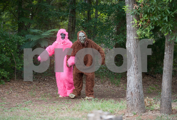 """photo by Sarah A. Miller/Tyler Morning Telegraph  Big Foot, right, and his girlfriend Pricilla appear out of the woods after campers sang Elvis' """"Hound Dog"""" at Camp Kennedy Wednesday. Camp Kennedy is a camp for adults with special needs held on the campus of Tyler Metro Church's Stonefort Camp in Whitehouse. Big Foot visits the camp each year making appearances at several camp events and is known to be an Elvis fan."""