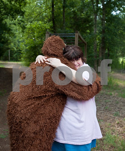 photo by Sarah A. Miller/Tyler Morning Telegraph  Big Foot hugs camper Michelle Sims at Camp Kennedy Wednesday. Camp Kennedy is a camp for adults with special needs held on the campus of Tyler Metro Church's Stonefort Camp in Whitehouse. Big Foot visits the camp each year making appearances at several camp events and is known to be an Elvis fan.