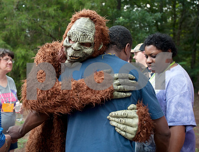 photo by Sarah A. Miller/Tyler Morning Telegraph  Big Foot hugs camper Bilal Khalid at Camp Kennedy Wednesday. Camp Kennedy is a camp for adults with special needs held on the campus of Tyler Metro Church's Stonefort Camp in Whitehouse. Big Foot visits the camp each year making appearances at several camp events and is known to be an Elvis fan.