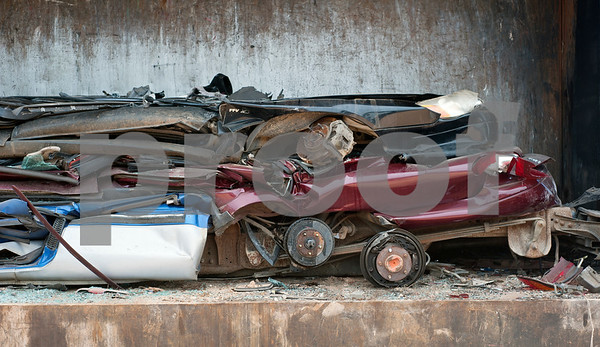 Vehicles whose time has run out to be sold for parts are crushed at Locos Gringos Pick-n-Pull Tuesday July 21, 2015. Locos Gringos, 10310 County Road 383 in Tyler, is an auto recycler that buys vehicles and sells them for parts in their self-service lot. They have about 900 automobiles on their 14 acre property.  (photo by Sarah A. Miller/Tyler Morning Telegraph)