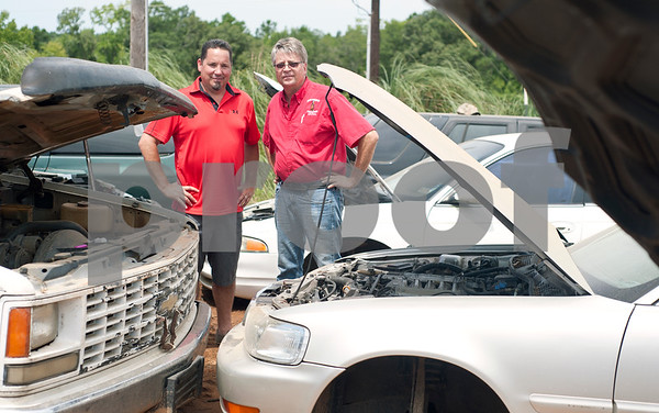 """Locos Gringos Pick-n-Pull owners Rick Sage and Gerald Scott are pictured Tuesday July 21, 2015 in their large lot of self-serve car parts. Locos Gringos held their famous """"all you can carry"""" sale Saturday July 25 where hundreds of customers purchased all the items they could carry off the lot for $75.   (photo by Sarah A. Miller/Tyler Morning Telegraph)"""