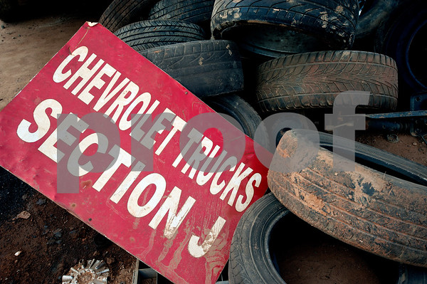 Tires removed from vehicles arriving at Locos Gringos Pick-n-Pull are placed in a pile Tuesday July 21, 2015. Locos Gringos, 10310 County Road 383 in Tyler, is an auto recycler that buys vehicles and sells them for parts in their self-service lot. They have about 900 automobiles on their 14 acre property.  (photo by Sarah A. Miller/Tyler Morning Telegraph)