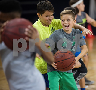 Andrew Gardner, 9, and Aaron Vidrine, 10, practice their pivots during a youth basketball camp held by the University of Texas at Tyler men's basketball coaching staff at the Louise Herrington Patriot Center. Campers learned skills such as shooting, ball handling and defense.  (Sarah A. Miller/Tyler Morning Telegraph)