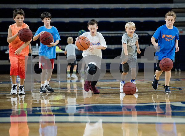 Campers dribble during a youth basketball camp held by the University of Texas at Tyler men's basketball coaching staff at the Louise Herrington Patriot Center. Campers learned skills such as shooting, ball handling and defense.  (Sarah A. Miller/Tyler Morning Telegraph)