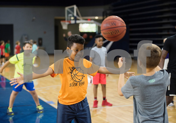 Campers practice passing during a youth basketball camp held by the University of Texas at Tyler men's basketball coaching staff at the Louise Herrington Patriot Center. Campers learned skills such as shooting, ball handling and defense.  (Sarah A. Miller/Tyler Morning Telegraph)