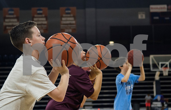 Campers practice a drill during a youth basketball camp held by the University of Texas at Tyler men's basketball coaching staff at the Louise Herrington Patriot Center. Campers learned skills such as shooting, ball handling and defense.  (Sarah A. Miller/Tyler Morning Telegraph)