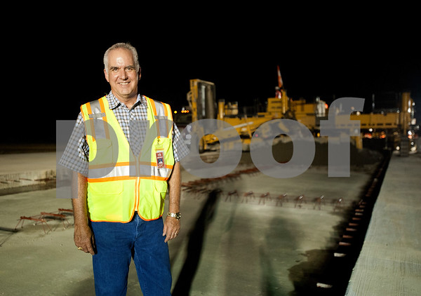 Airport manager Davis Dickson is pictured Tuesday night at the construction site for improving runway 4-22 at Tyler Pounds Regional Airport.  (photo by Sarah A. Miller/Tyler Morning Telegraph)
