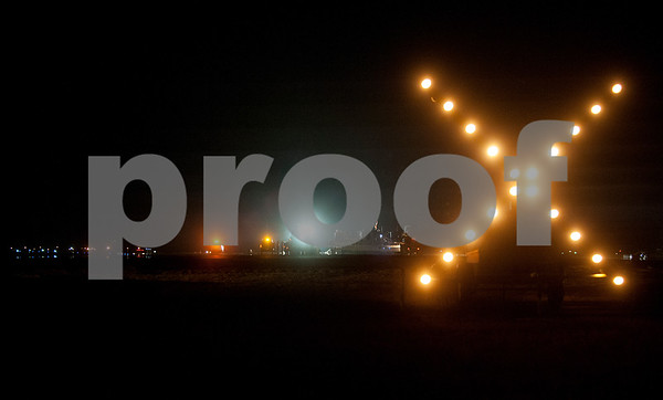A lighted X tells pilots that runway 4-22 is closed Tuesday night at Tyler Pounds Regional Airport. The runway is being reconstructed concrete.  (photo by Sarah A. Miller/Tyler Morning Telegraph)