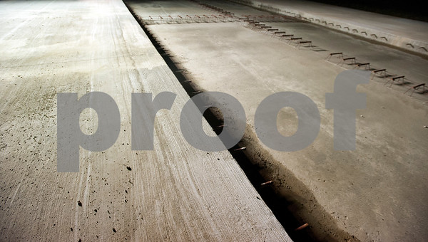 Runway 4-22 is reconstructed with segments of 14 inch thick concrete Tuesday night at Tyler Pounds Regional Airport.   (photo by Sarah A. Miller/Tyler Morning Telegraph)
