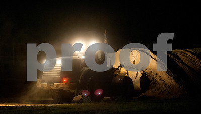 Materials for concrete are piled waiting to be moved by dump trucks into a batch plant then used for reconstructing runway 4-22 at Tyler Pounds Regional Airport Tuesday night.   (photo by Sarah A. Miller/Tyler Morning Telegraph)