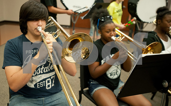 Winona Wildcat Band sophomore Anthony Cardenas plays a trombone during pre-camp Friday at Winona High School. Marching band camp officially starts Monday, but the Winona band got a head start learning their music this week.  (photo by Sarah A. Miller/Tyler Morning Telegraph)