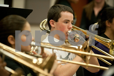 Winona Wildcat Band sophomore Michael Campbell plays a trombone during pre-camp Friday at Winona High School. Marching band camp officially starts Monday, but the Winona band got a head start learning their music this week.  (photo by Sarah A. Miller/Tyler Morning Telegraph)