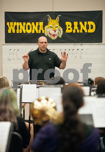 Winona Wildcat Band director Jerry Whorton conducts a warm-up during pre-camp Friday at Winona High School. Marching band camp officially starts Monday, but the Winona band got a head start learning their music this week.  (photo by Sarah A. Miller/Tyler Morning Telegraph)