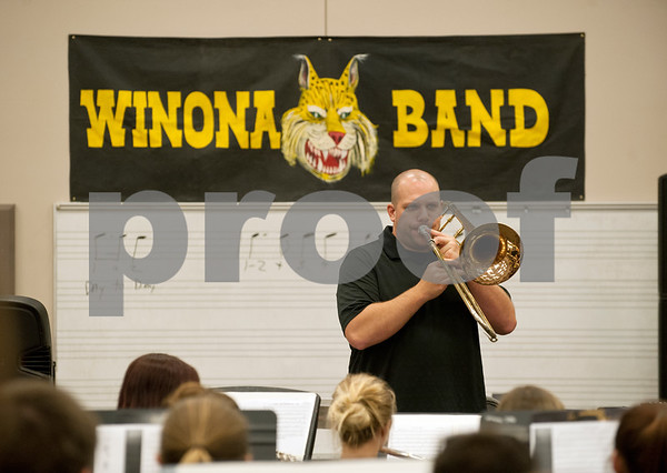 "Winona Wildcat Band director Jerry Whorton demonstrates articulation for ""The Hey Song"" on a trombone during pre-camp Friday at Winona High School. Marching band camp officially starts Monday, but the Winona band got a head start learning their music this week.  (photo by Sarah A. Miller/Tyler Morning Telegraph)"