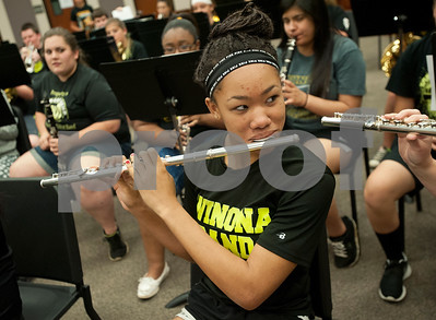 Winona Wildcat Band junior Terra Moore, 15, practices a song on her flute during pre-camp Friday at Winona High School. Marching band camp officially starts Monday, but the Winona band got a head start learning their music this week.  (photo by Sarah A. Miller/Tyler Morning Telegraph)