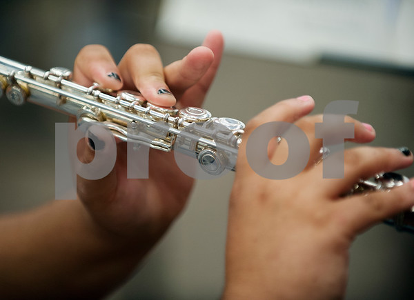 Winona Wildcat Band freshman Kori Jones plays a flute during pre-camp Friday at Winona High School. Marching band camp officially starts Monday, but the Winona band got a head start learning their music this week.  (photo by Sarah A. Miller/Tyler Morning Telegraph)