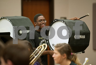 Winona Wildcat Band freshman Larry Hampton plays a bass drum during pre-camp Friday at Winona High School. Marching band camp officially starts Monday, but the Winona band got a head start learning their music this week.  (photo by Sarah A. Miller/Tyler Morning Telegraph)