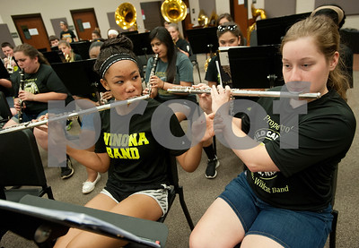Winona Wildcat Band junior Terra Moore, 15, and senior Sara Bass, 17, practice a song on their flutes during pre-camp Friday at Winona High School. Marching band camp officially starts Monday, but the Winona band got a head start learning their music this week.  (photo by Sarah A. Miller/Tyler Morning Telegraph)
