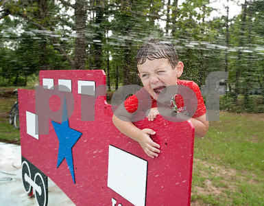 Lathan Campbell, 4, of Teneha, plays on the train themed splash ground at the Texas State Railroad Campground in Rusk Friday. The campground is the site of the  Texas Hobo Cook-Off & Gypsy Jamboree which is a partnership between the Cherokee 4-H Parent & Adult Leaders' Association and Texas State Railroad. Saturday's events will include several different barbecue cooking contests and a train ride.    (photo by Sarah A. Miller/Tyler Morning Telegraph)