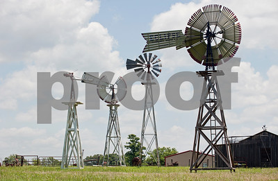 Four windmills stand in Wayne and Jennifer Rogers' yard in New Harmony. The yard is home to several more windmills, not all standing.  (photo by Sarah A. Miller/Tyler Morning Telegraph)