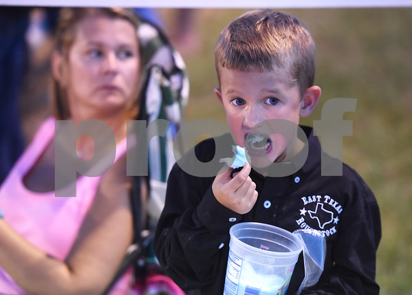 Hudson Skinner, 6, of Canton, eats cotton candy Friday night July 8, 2016 at the 54th Annual Mineola Volunteer Fire Department Rodeo. The show continues Saturday at 8 p.m. Skinner was the mutton bustin champion.  (Sarah A. Miller/Tyler Morning Telegraph)