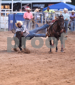 Brandon Harrison of Beaumont wrestles a steer Friday night July 8, 2016 at the 54th Annual Mineola Volunteer Fire Department Rodeo. The show continues Saturday at 8 p.m.   (Sarah A. Miller/Tyler Morning Telegraph)