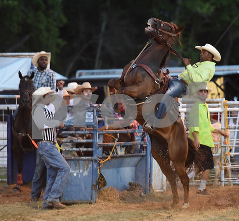 Dwayne Ford of Beaumont stays on his horse at it bucks before the steer wrestling competition Friday night July 8, 2016 at the 54th Annual Mineola Volunteer Fire Department Rodeo. The show continues Saturday at 8 p.m. Skinner was the mutton bustin champion.  (Sarah A. Miller/Tyler Morning Telegraph)