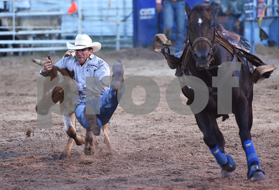 Seth Cooke of Weatherford wrestles a steer Friday night July 8, 2016 at the 54th Annual Mineola Volunteer Fire Department Rodeo. The show continues Saturday at 8 p.m.   (Sarah A. Miller/Tyler Morning Telegraph)