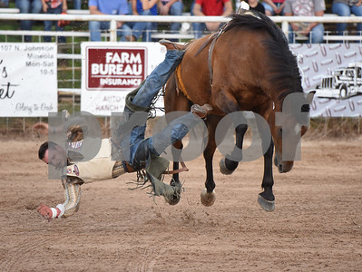 Taylor Broussard of Estherwood, Louisiana falls as he rides bareback Friday night July 8, 2016 at the 54th Annual Mineola Volunteer Fire Department Rodeo. The show continues Saturday at 8 p.m.   (Sarah A. Miller/Tyler Morning Telegraph)