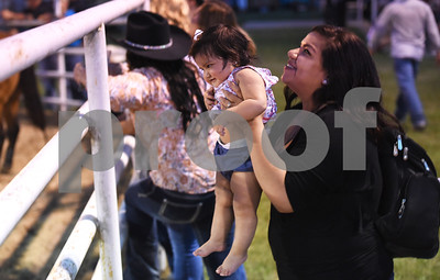 Rosa Nunez of Mineola bounces her 10-month-old daughter Adilenne Nunez Friday night July 8, 2016 at the 54th Annual Mineola Volunteer Fire Department Rodeo. The show continues Saturday at 8 p.m. Skinner was the mutton bustin champion.  (Sarah A. Miller/Tyler Morning Telegraph)
