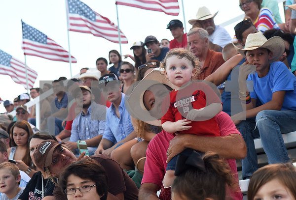 Scott Hughes of Alba holds his grandson Ashton Labobe, 1, on his lap for his first rodeo Friday night July 8, 2016 at the 54th Annual Mineola Volunteer Fire Department Rodeo. The show continues Saturday at 8 p.m.  (Sarah A. Miller/Tyler Morning Telegraph)