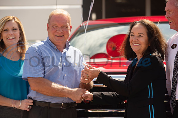 Phil Smith of Whitehouse and his wife Nancy Smith, at left, accept the keys to their new truck from Hall Buick GMC owner Pam Hall and General Manager Monte Hall on Tuesday July 9, 2019. Smith was the winner of a 2019 GMC Sierra SLT Crew Cab Cattle Barons' Edition from a raffle at the Cattle Barons' Gala.  The Cattle Barons' Gala is the primary fundraiser for the American Cancer Society in Tyler.  (Sarah A. Miller/Tyler Morning Telegraph)
