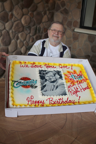 """LAWRENCE PANTAGES / GAZETTE Retired Cavaliers radio announcer Joe Tait had a special cake made for a surprise 80th birthday, held Saturday at Samosky's restaurant in Valley City in Liverpool Township. The writing on the right side of the cake has Tait's traditional play-by-play call on a dunk -- """"Wham with the right hand!"""""""