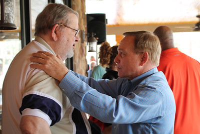 LAWRENCE PANTAGES / GAZETTE Retired Cavaliers radio announcer Joe Tait is greeted by former Cleveland head coach Mike Fratello on Saturday at Samosky's restaurant in Valley City in Liverpool Township. The occasion was a surprise 80th birthday party for Tait.