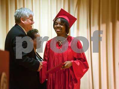 photo by Sarah A. Miller/Tyler Morning Telegraph  Robert E. Lee student Kry-Shaunna Masters receives her diploma from TISD superintendent Gary Mooring Thursday during the TISD summer commencement ceremony. Students who were ineligible for the traditional spring ceremony were able to take summer school classes and retest for the summer commencement which was held at the UT-Tyler Ornelas Activity Center.