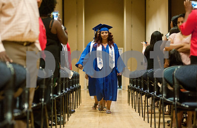 photo by Sarah A. Miller/Tyler Morning Telegraph  John Tyler High School student Martha Delgado leads the processional of graduation candidates Thursday during the TISD summer commencement ceremony. Students who were ineligible for the traditional spring ceremony were able to take summer school classes and retest for the summer commencement.