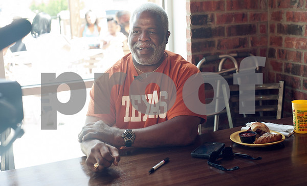 Earl Campbell gives an interview to the press during a kick-off event for Earl Campbell Signature Dishes at Rotolo's Pizzeria in Tyler Tuesday Aug. 18, 2015. The new dishes, including a pizza, sandwich, calzone and pasta feature Earl Campbell brand smoked sausage. Campbell is a former professional football player and Heisman Trophy winner from Tyler.   (Sarah A. Miller/Tyler Morning Telegraph)