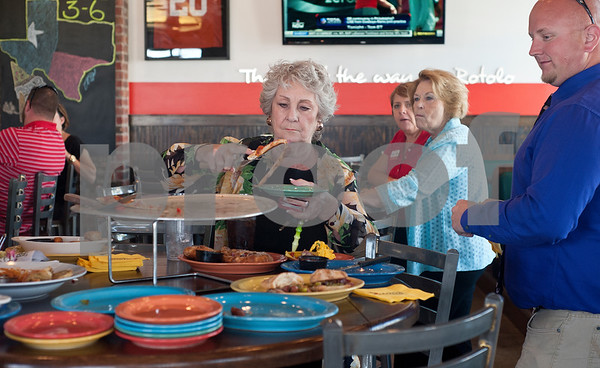 Anneita Piediscalzi of Tyler tries a slice of Earl Campbell sausage pizza during a kick-off event for Earl Campbell Signature Dishes at Rotolo's Pizzeria in Tyler Tuesday Aug. 18, 2015. The new dishes, including a pizza, sandwich, calzone and pasta feature Earl Campbell brand smoked sausage. Campbell is a former professional football player and Heisman Trophy winner from Tyler.   (Sarah A. Miller/Tyler Morning Telegraph)