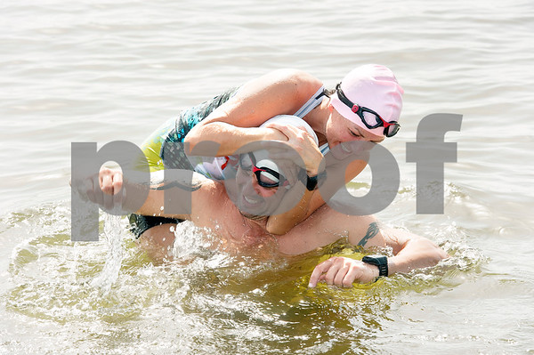 photo by Sarah A. Miller/Tyler Morning Telegraph  Cori and Ryan Moore of Flint, Texas goof around at Lake Tyler during their Ironman training Wednesday Aug. 20, 2014. The couple are competing in Ironman Louisville in Louisville, Kentucky Sunday. An ironman triathlon race includes long-distance swimming, bicycling and running races.
