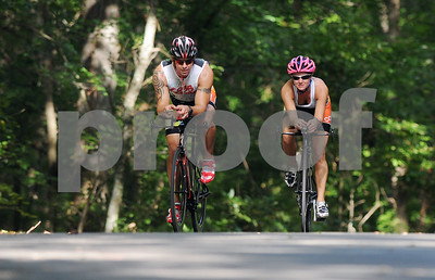 photo by Sarah A. Miller/Tyler Morning Telegraph  Cori and Ryan Moore of Flint, Texas bike down McElroy Road in Whitehouse as part of their Ironman training Wednesday Aug. 20, 2014. The couple are competing in Ironman Louisville in Louisville, Kentucky Sunday. An ironman triathlon race includes long-distance swimming, bicycling and running races.