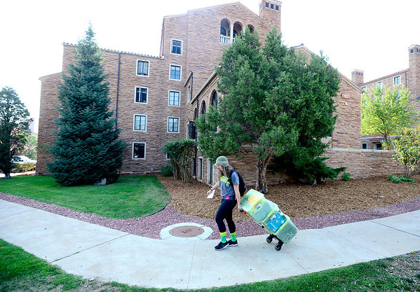 Caroline Atsaves, freshman in international affairs, walks around Farrand Hall pulling a dolly with some of her luggage during early move in at the University of Colorado in Boulder, Colorado August 21, 2012.  DAILY CAMERA MARK LEFFINGWELL