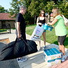 Dan Bennett (left) and Rosy Bennett (right) help their daughter, Lauren Bennett (middle), freshman in integrated physiology, get her things organized while moving in Arnett Hall at the University of Colorado in Boulder, Colorado August 21, 2012.  DAILY CAMERA MARK LEFFINGWELL