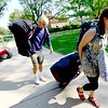 Mackenzie Combs (left), freshman in architecture, gets help from his sister Emily Combs (right) moving in to Hallett Hall during early move in at the University of Colorado in Boulder, Colorado August 21, 2012.  DAILY CAMERA MARK LEFFINGWELL